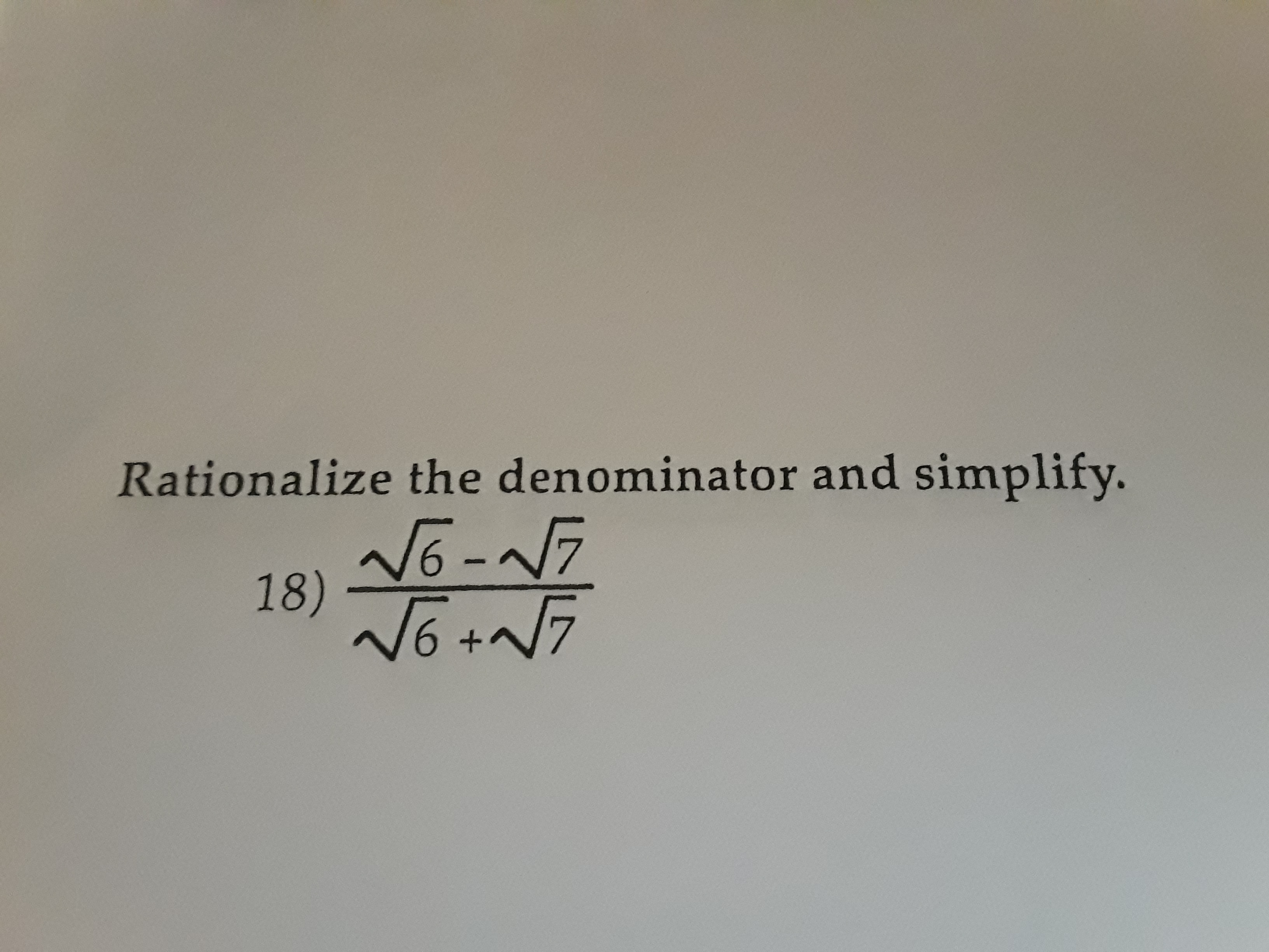 Rationalize the denominator and simplify. 6 NG-N7 18) +A