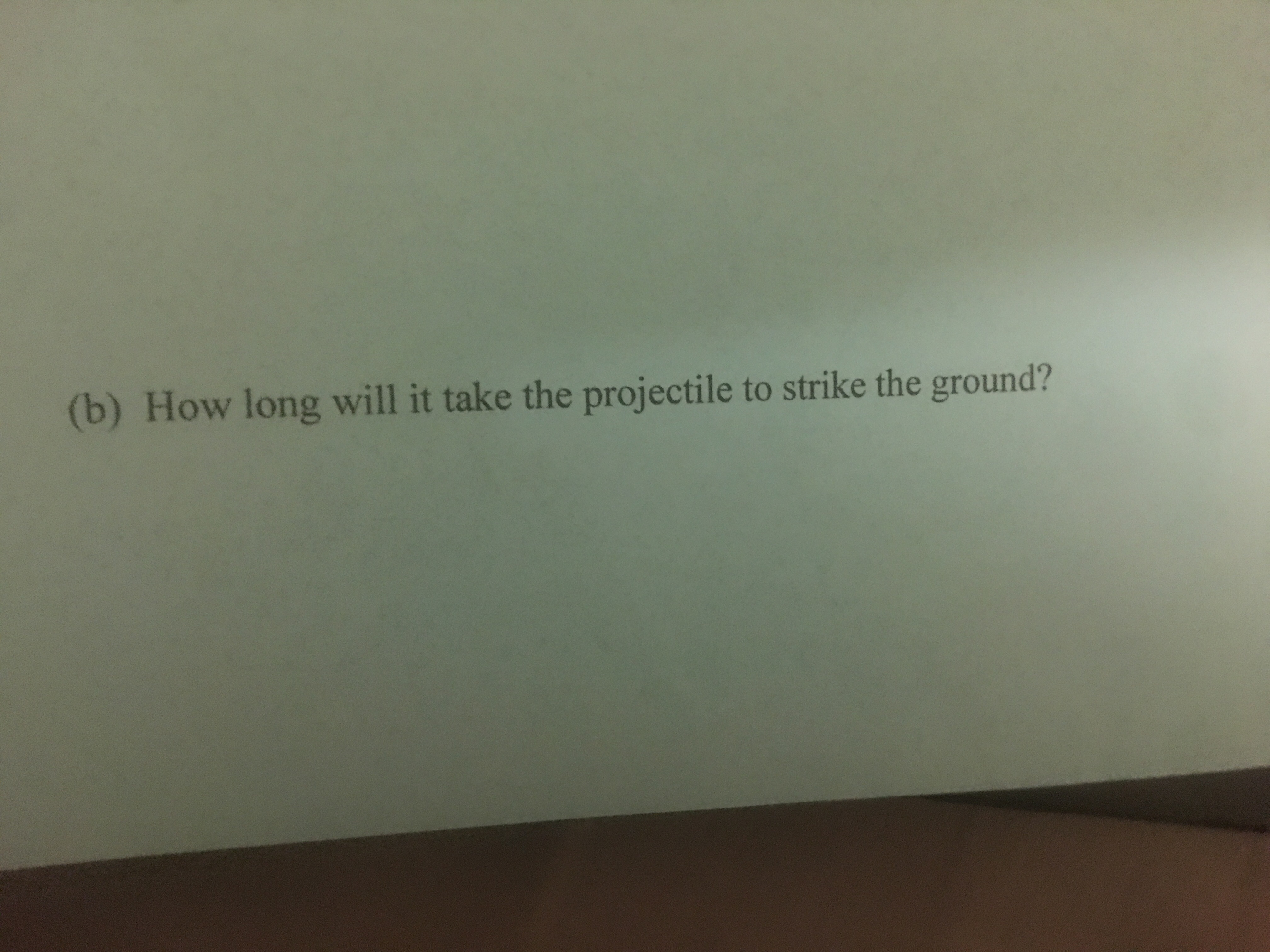 (b) How long will it take the projectile to strike the ground?