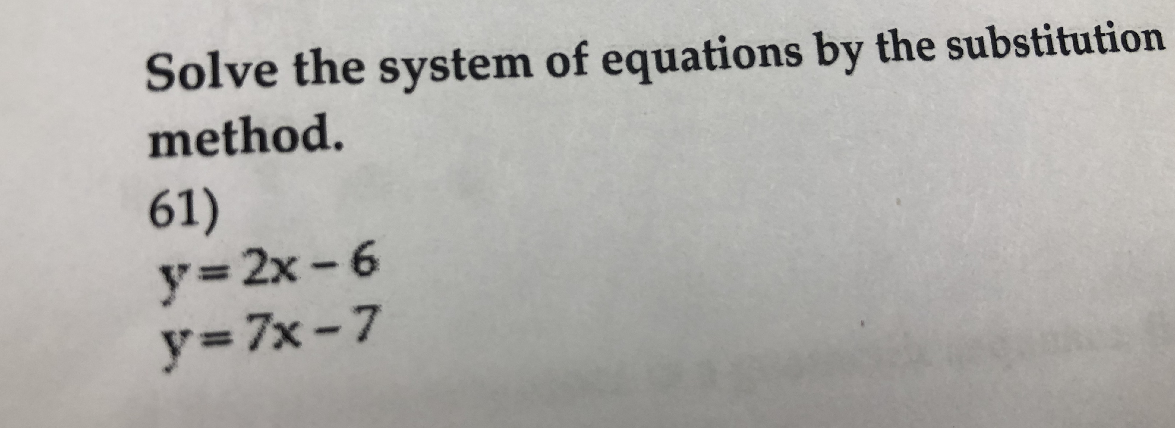 Solve the system of equations by the substitution method. 61) y-7x-7