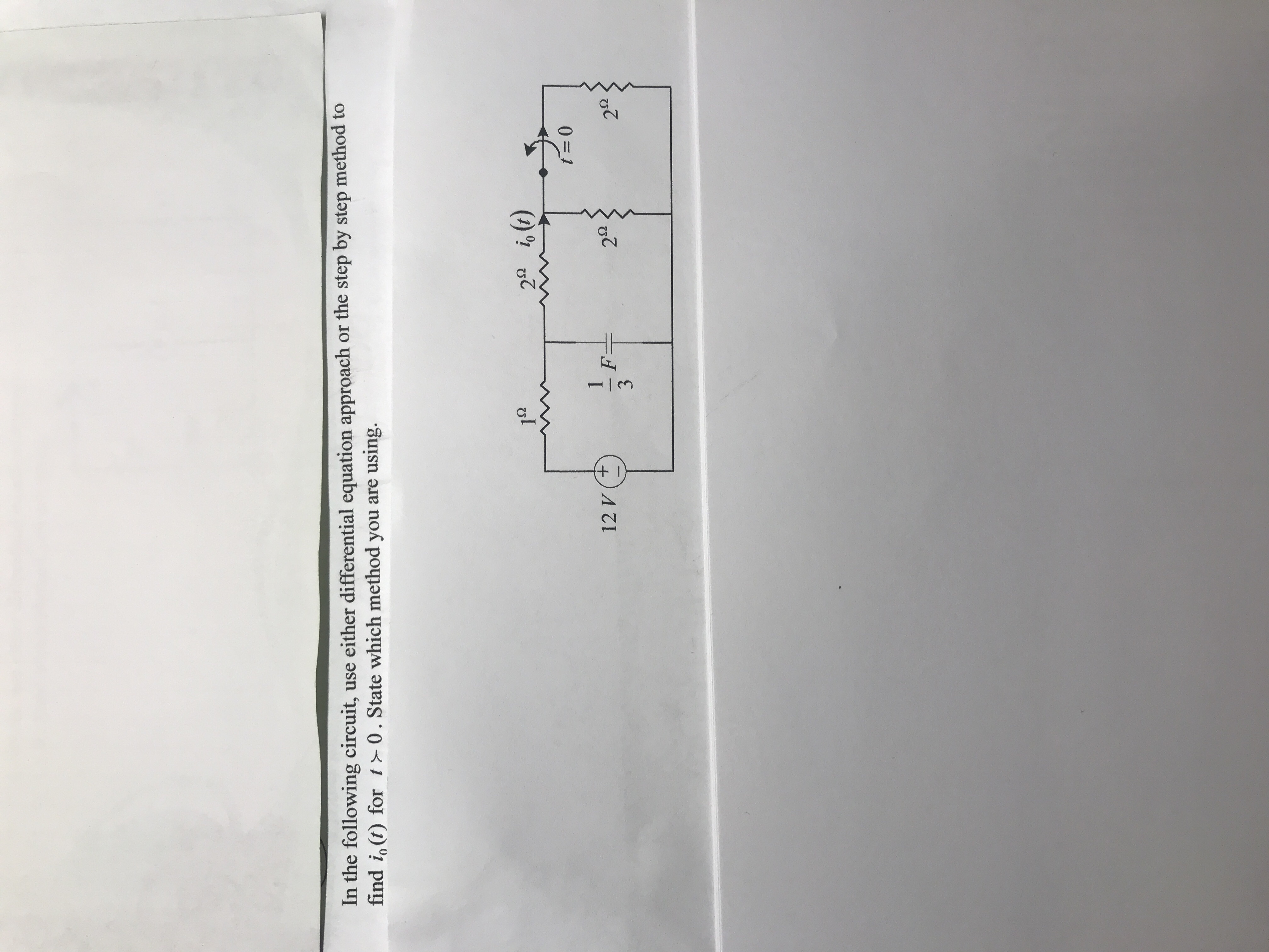 In the following circuit, use either differential equation approach or the step by step method to find i。(t) for t 0 . State which method you are using. 1s2 29 る(1) 12 V(+ 2Ω 2Ω